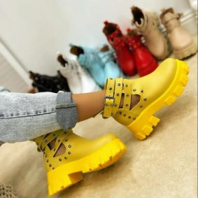 ANKLE BOOTS WITH BELTS AND RIVETS - YELLOW